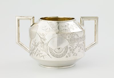 angular design--pair of angular handles; pointed shoulder; wide mouth; decorated with Asian-style designs of cranes, bamboo, fan shapes, the moon and flowers