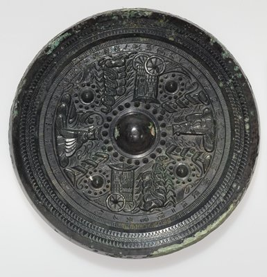mirror, round, with pictorial decoration in relief, Yeuh type