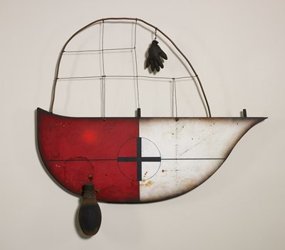 wall hanging/relief; boat-shaped element at bottom with white on right side and red on left side and a cross inside a circle in black pigment at center; loop of thick wire at top with partial grid made of thinner wires; child-sized black three-dimensional hand hanging from loops of wire at top right; bulbous element in brown with encrustations at top attached on lower left with wire