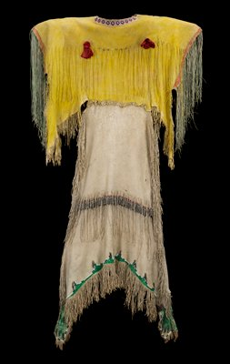 yellow bodice with red trim on sleeves; long, thin green fringe at arm openings; two red silk rosette-like pouches (medicine bundles)--both open and empty--on front chest with long fringe and gold metallic beads; rows of multicolored beadwork diamonds at front and back neckline, edged in white; upper back has similar long fringe with gold beads, one intact red silk rosette-pouch and small cylindrical beaded element with multicolored horizontal rows of beads; natural colored skirt with fringe at sides and bottom hem; two green rectangular tabs and left and right sides at hem, edged with short fringe and white, light and dark blue beading and metal cones; green scalloped design at hem trimmed with similar beading; horizontal row of fringe and metal cones with green, red and white beadwork at middle of skirt, front and back