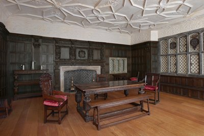 Filler panels above doors (part of Tudor Room), wood, English XVIc stored in strip frame behind MacFarlane Room; An envelope of bits from the room is stored in D11.5 MS.