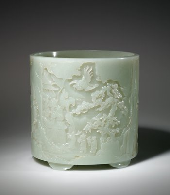 white jade, decorated in under cut relief with scenes symbolic of the Buddhistic paradise.  Trees and strange bird forms elaborate the main design, and tiny human figures climb a winding path to the pagoda in the sky.