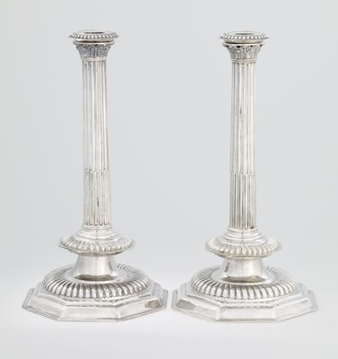 a pair of exceptionally rare, unusually large sized William and Mary candlesticks; plain octagonal bases, with large bold gadroon above, fluted columns with gadroon at the base, the upper part of the columns surmounted with leaves, removable bobeche