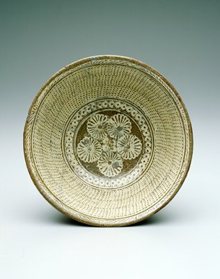 Mishima Bowl; all-over comb motif with five flowers in interior and band of flowers circling sides; pottery with grey glaze, stoneware