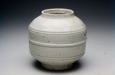jar ovoid, footed body with incised bands circling body and short, straight neck