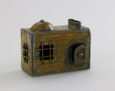 rectangular architectural form with dome on top; 3 barred windows; handle on back; incised on top and front