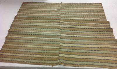 two panels; weft-face ikat; natural dye; banding of white, tan, blue and green alternating with bands of ikat