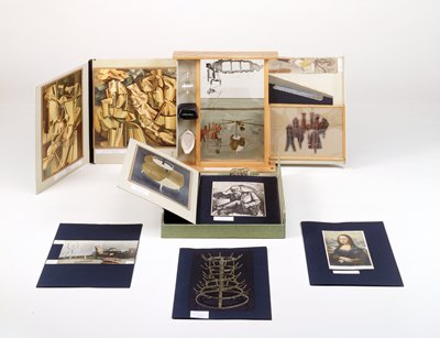 Editioned artist multiple, Series D (1961); 'Duchamp's miniature museum' containing replicas of objects and printed reproductions of works in all media by the artist; three sliding panels, one wood stand; four three-dimensional objects; portfolio of folders (27 pages) inside inner compartment; outside light green linen, lining light green Ingres paper; box contains 68 items. No outer leather case (valise), as published.