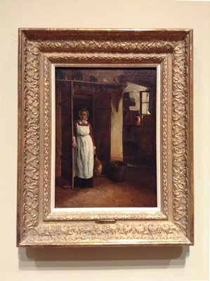 interior, woman emerging from a doorway at left holding a large storage vessel in proper left hand and the door on her right; window with light shining through at upper right corner, water bucket to right of doorway on floor