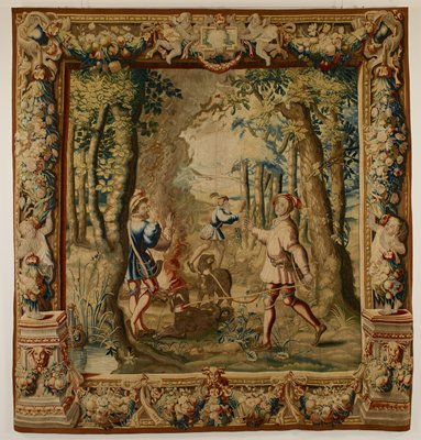 one of a set of four tapestries, with woodland scene in grove of trees; the huntsmen have made a fire of logs, and one of them stands before it warming his hands, while a second dressed in crimson holds two panting brown hounds on leash. Beyond, a third hunter shields face from fire with left hand, and holds in his right a trophy of the hunt; warp undyed wool, 7½-9 ends per cm., weft dyed wool and silk, 28-40 ends per cm.
