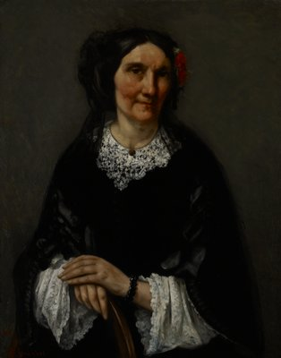 Portrait of a woman. The subject faces the spectator, the left arm resting on the back of a side chair. Black satin gown, deep lace collar and cuffs. Black lace scarf draped over back of head, red flower in hair.