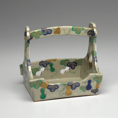 handled tray with short sides; light grey glaze with blue, green and gold leaves, vines and gourds; cutout gourd shapes