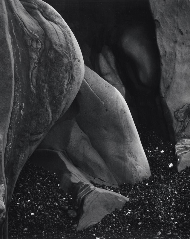 striated rocks with dark pebbles