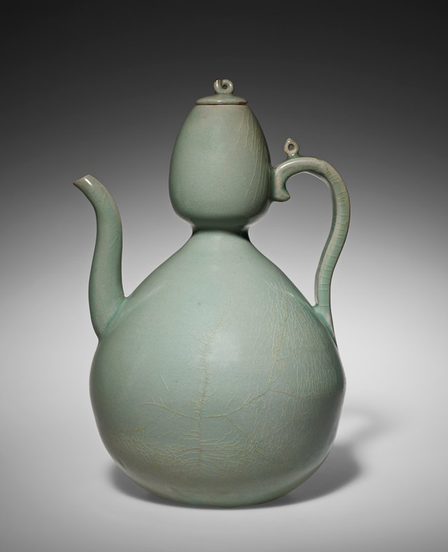 Gourd-shaped with lid; spade-shaped protrusion with opening on top of ewer handle; top of curl on lid handle is gilded; has lidded wooden box