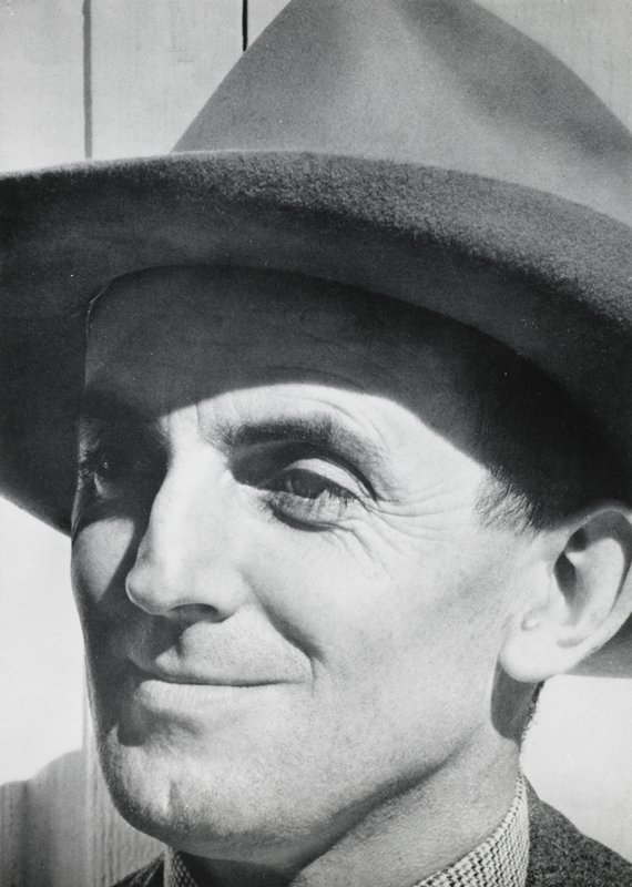 close-up portrait of Ansel Adams, slightly smiling; wearing a fedora