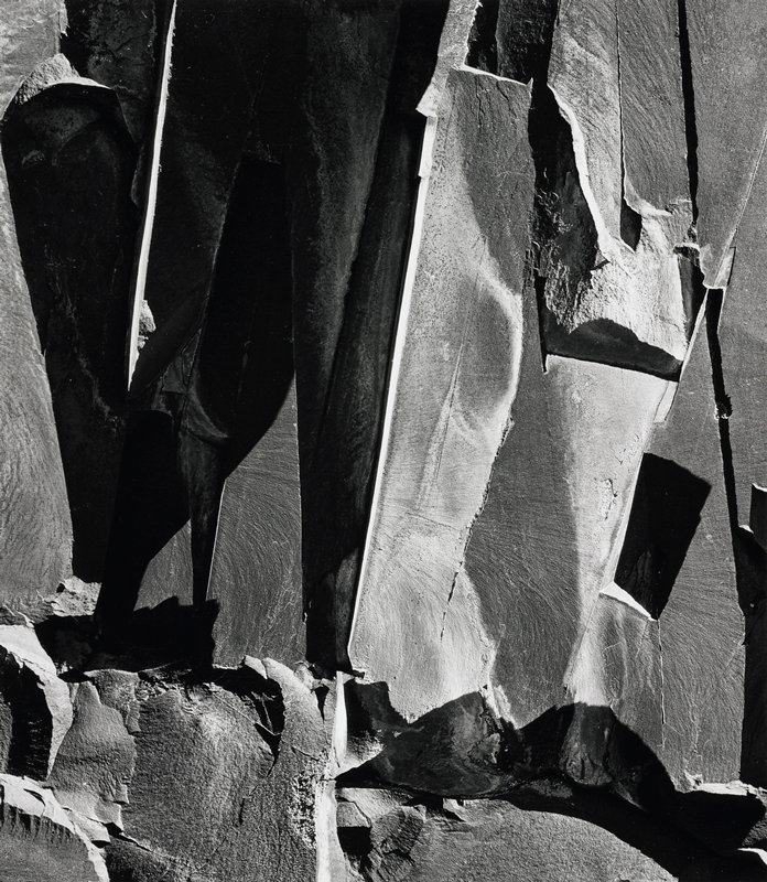 light and shadows show texture and shape of rocks which appear jagged and sheared