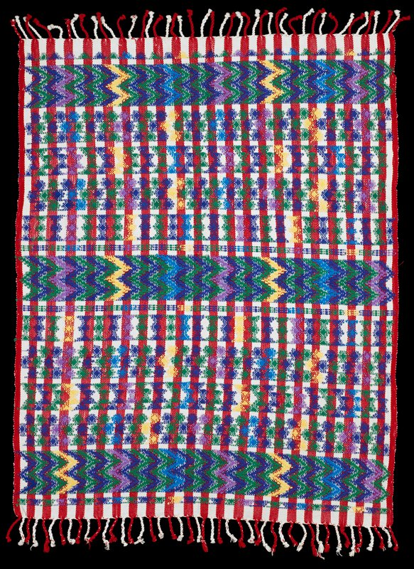 red and white striped; woven with purples, green and yellow in various geometric bands