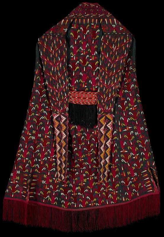 sleeveless cape without arm openings; open front; H-shaped back piece; green ground fabric with red, pink, yellow, white and blue embroidered organic tulip-like motifs overall; geometric embroidery around neck; tails on back piece embroidered with predominately pin and blue daisy-like design; center of back piece is orange with X's; maroon fringe at bottom