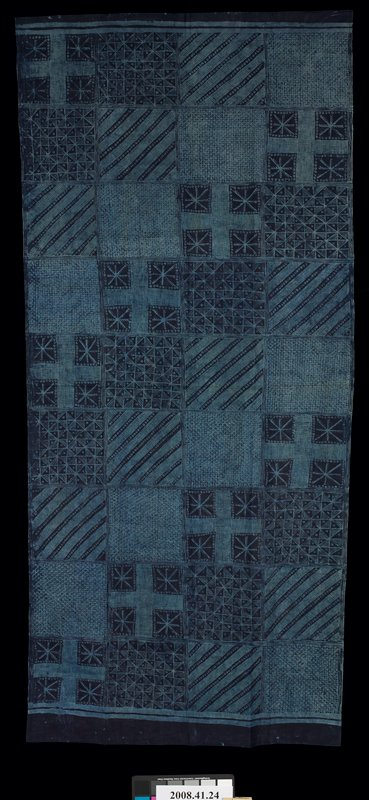 panel, hemmed on two sides; indigo with light blue patchwork-like designs with four different geometric patterns, including snowflake-like design; starch resist