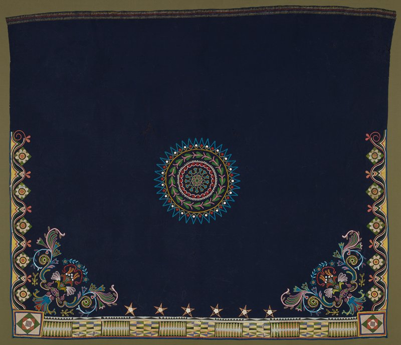 blue; central beaded round medallion with leaf designs and organic shapes; large beaded floral designs in lower corners; silk appliqué in predominantly pink, green and yellow on bottom hem and part of sides in floral and geometric designs; six appliquéd stars at bottom in pink and cream; blue backing (modern)