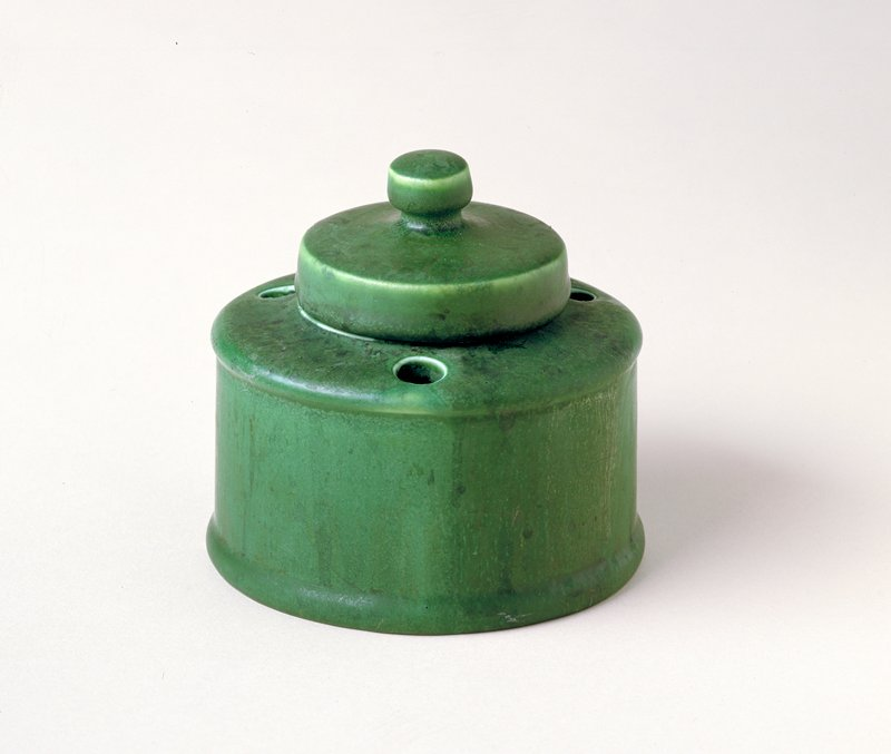 Inkwell with lid, ceramic, American, XX c. cat. card dims H. 4', Diam. 4'; lid 2-1/2' matte green glaze