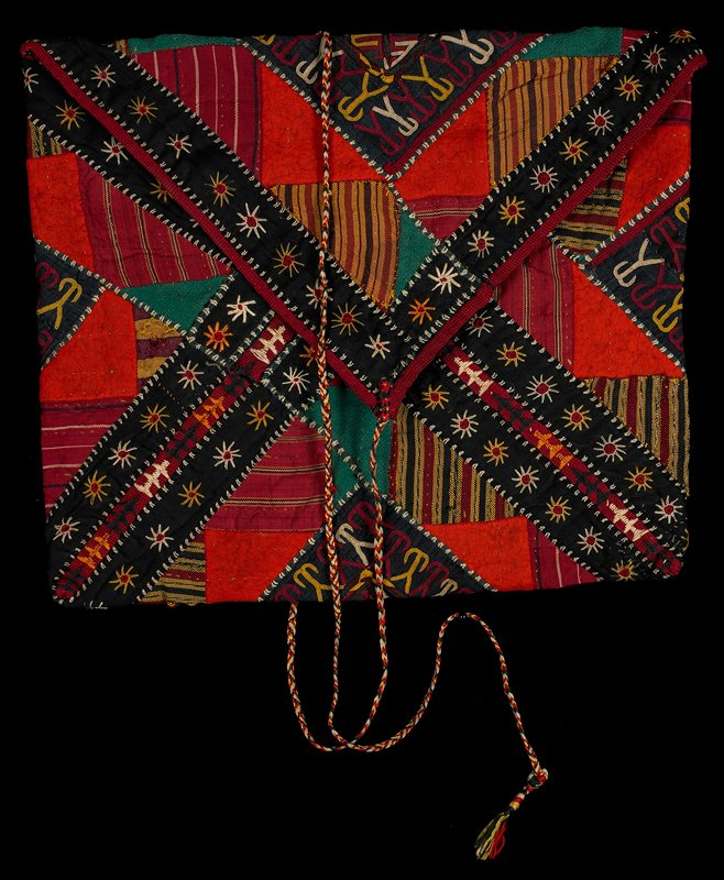 "envelope-style pouch with long multicolored braided cord closure; embroidery in maroon, yellow, white, green and brown with large cross and ""E"" motifs on back; front has edging bands of black with yellow, red and white starbursts; striped and plain appliqués"