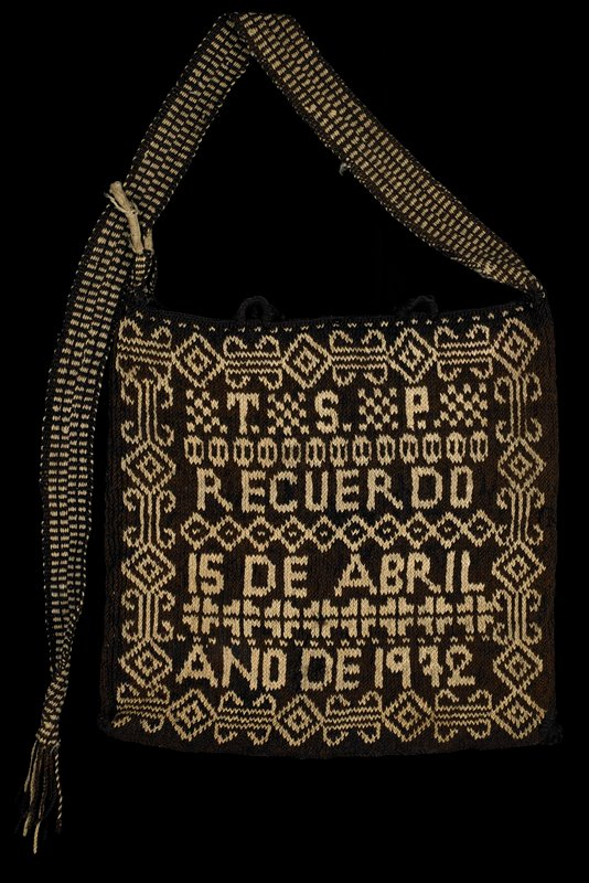 """bag in brown and tan; pouch with strap affixed at one end-other end loose for adjustability; geometric and curvilinear border designs and designs separating text (same on both sides): """"T.S.P./ RECUERDO/ 15 DE ABRIL/ ANO DE 1972]"""