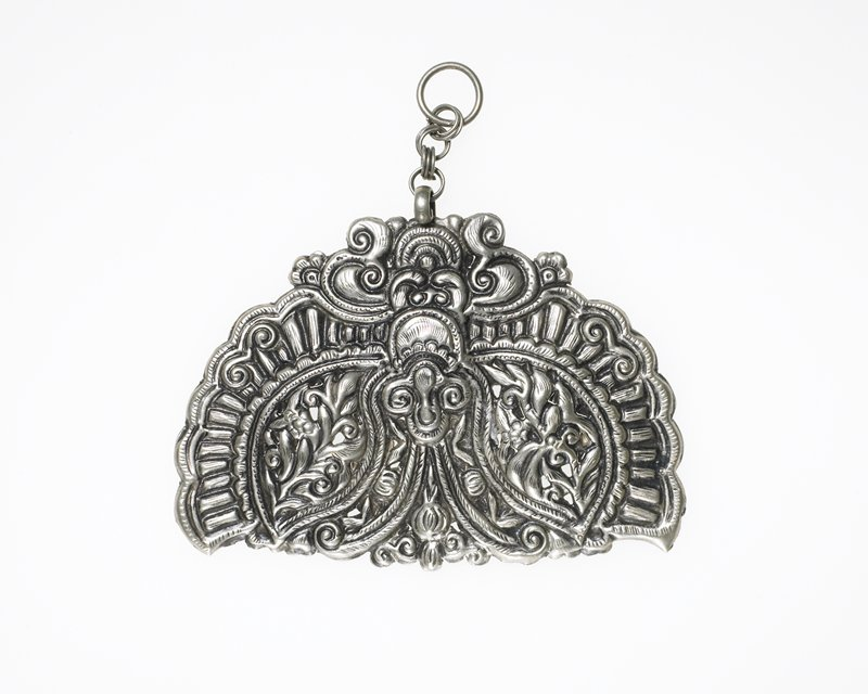 semi-circular pendant; relief motifs, floral and foliate; scalloped edges; resembles butterfly upside down; loop at top attached by four links to pendant