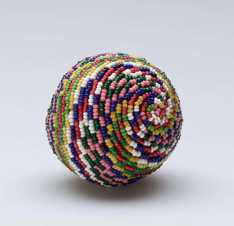 small ball with multicolored beads in a spiraling design