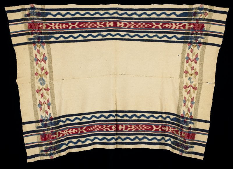 two strips sewn together; cream-colored with dark blue, medium blue, red and green woven stripes, ikat wavy lines, ikat stripes and floral vine designs