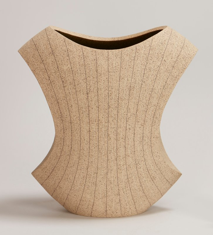 flat base; rather torso-shaped; spotted tan and brown; brown and white thin vertical stripes; very dark green oribe glaze on interior