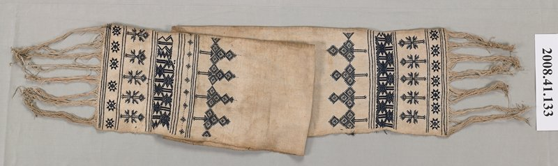 tan with black, geometric embroidery with four wide bands at ends; self fringe