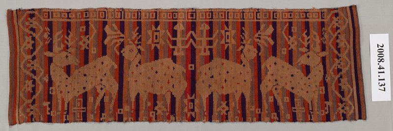 woven panel of vertical stripes in orange, gold, black and grey; design of deer and geometric figures in tan across fabric