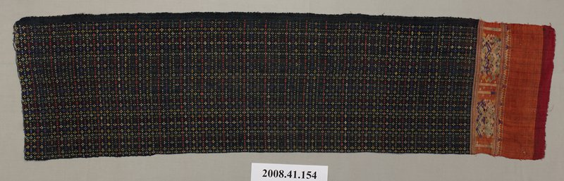 black shoulder cloth with multicolored embroidery and embroidered orange silk hem at one end; embroidery pattern on main panel of cloth of small crosses and lines; on silk hem panels are embroidered geometric motifs in green, gold and purple threads; solid black fabric border at bottom of cloth