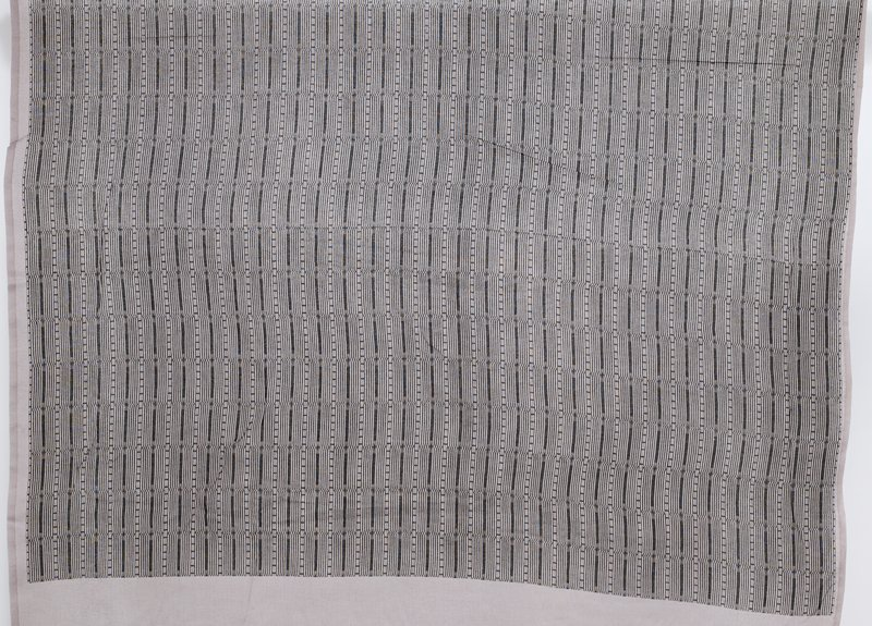 repeated pattern of dashed lines with lines in slight wave pattern; black printed on grey; geometric pattern; block printed; printing does not extend to ends of fabric--wider bands at each end, narrow uneven bands at sides