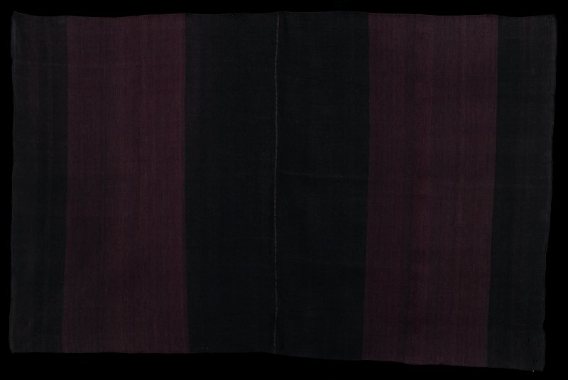 two pieces sewn together; stitched edging on two short sides; each panel has two dark brown stripes flanking slightly lighter brown stripe; warp faced plain weave