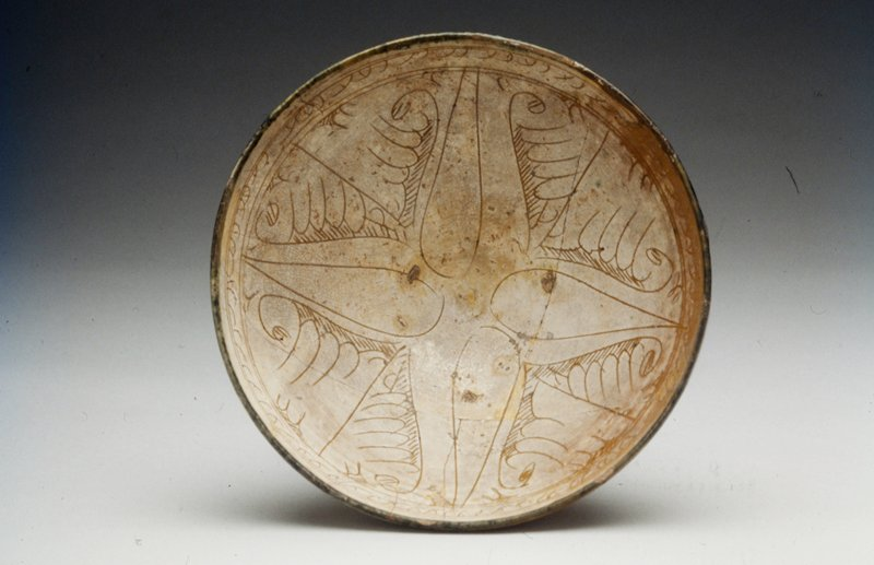 Bowl, Graffito Ware; incised white glaze with green rim. Earthenware with sgraffito decor under white glaze.