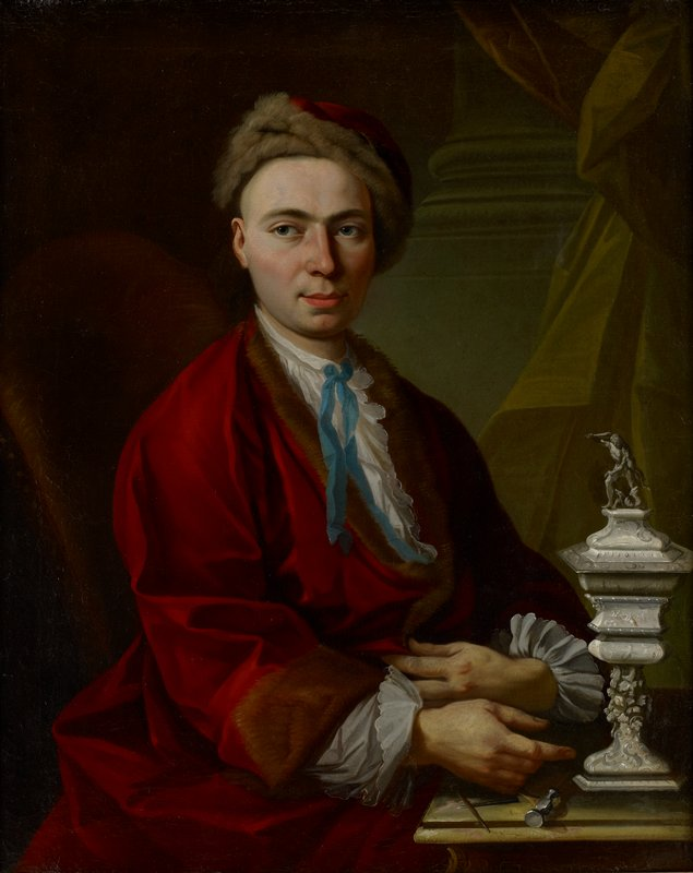 portrait of a balding man wearing a red cap lined in brown fur, red coat with brown fur trim and white shirt with blue tie; silver masterpiece cup on tabletop at right, with silver working mallet and tools under man's hand