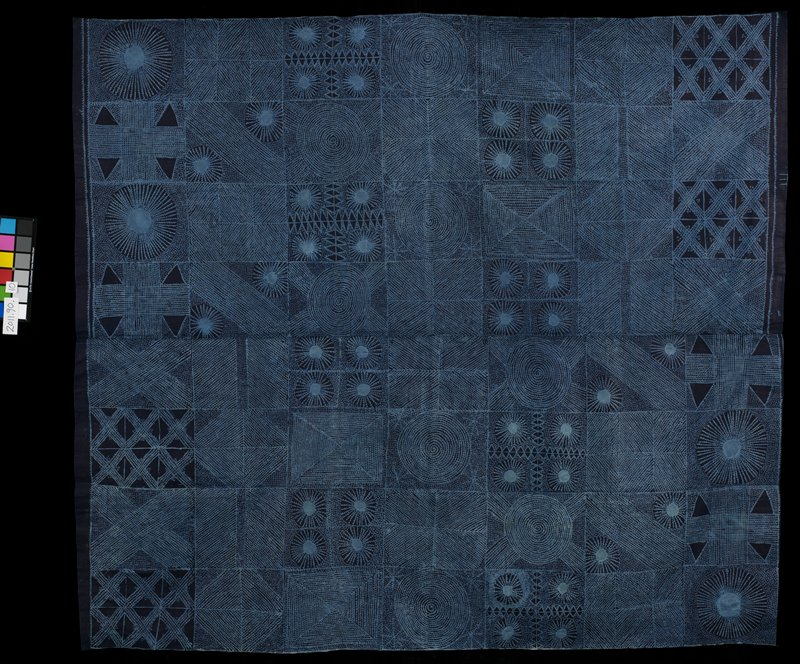 dark and light blue design; geometric motifs - large squares enclose smaller motifs including circles, triangles and diamonds; dark blue ground, light patterns; 2 panels joined at center
