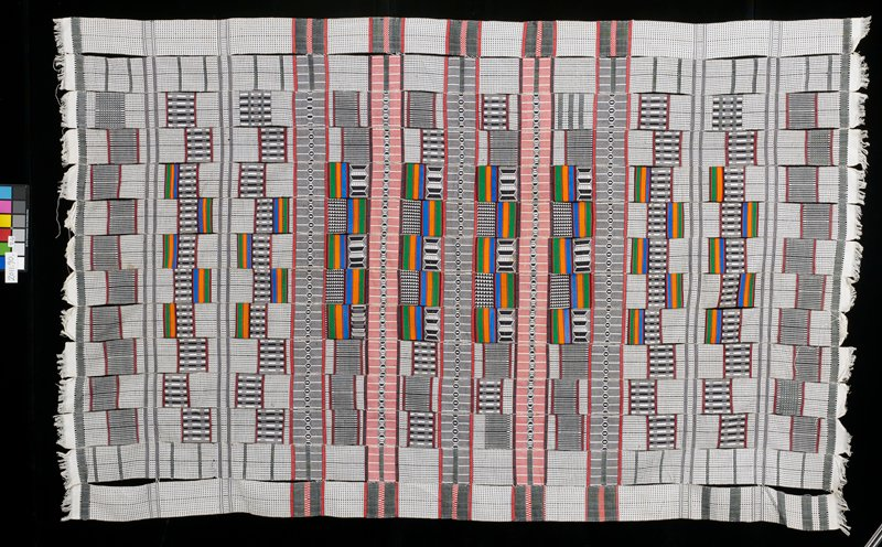 14 panels of woven multicolored cotton with white fringe; panels have multicolored striped patches and black and white sections of abstract design; white fringe on short edges; strips loosely sewn together; loose threads on many edges