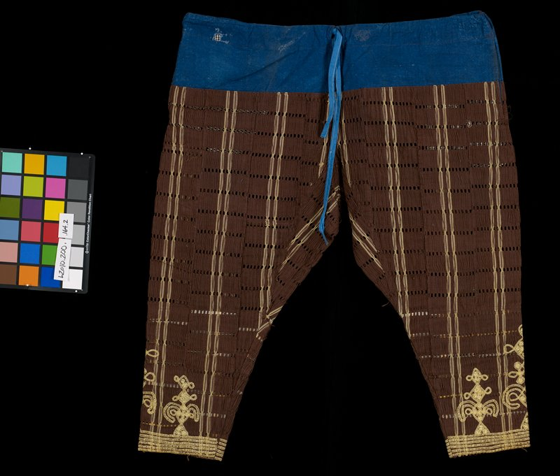 man's pants go with L2010.200.164.1; made from same brown fabric with gold stripes and woven holes connected vertically by brown thread on the surface; wide band of gold embroidery at cuffs and up leg; blue drawstring panel at top; side seam pockets small black and white checked fabric