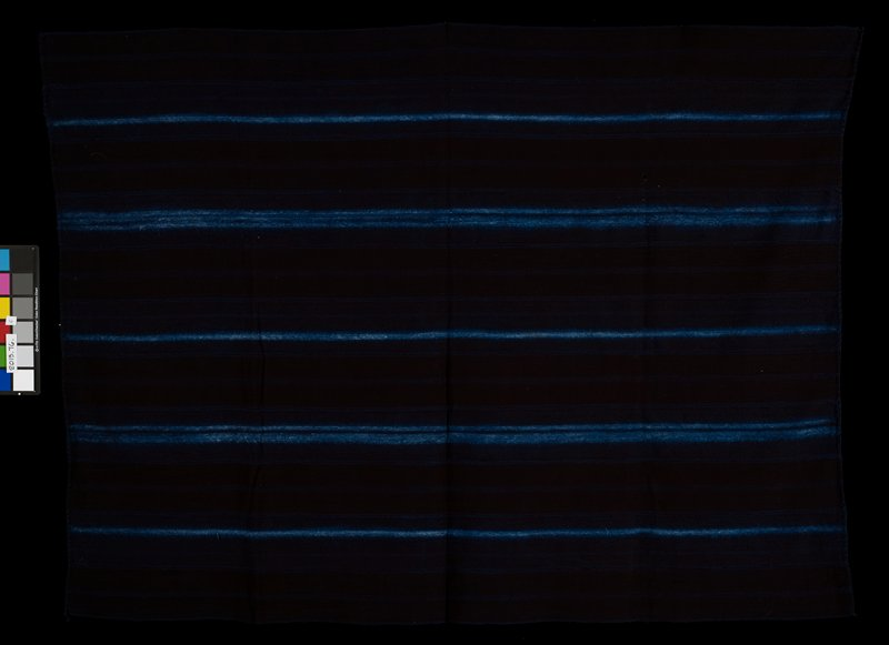 eleven paneled, black cloth with blue tie-dyed stripes; some stripes are single and some are triple; blue striped panels are interspersed with plain black panels