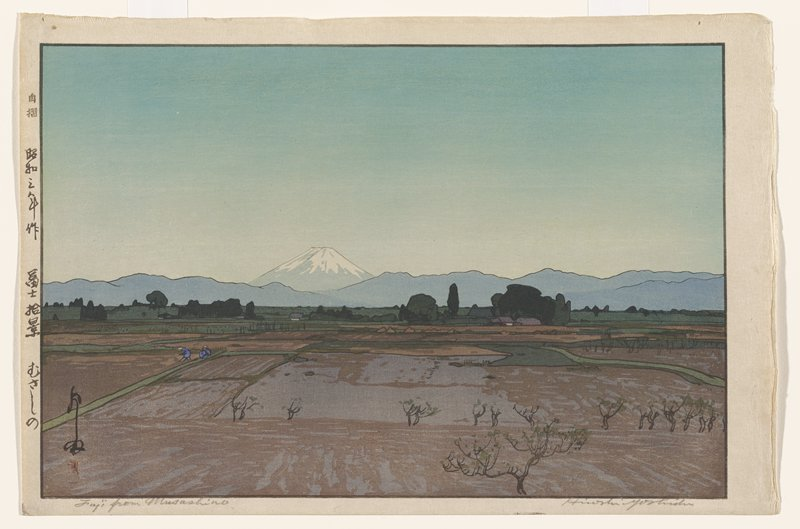 fields with some small trees with few leaves in foreground; two figures in blue on strip of green in LLQ; Mount Fuji in background