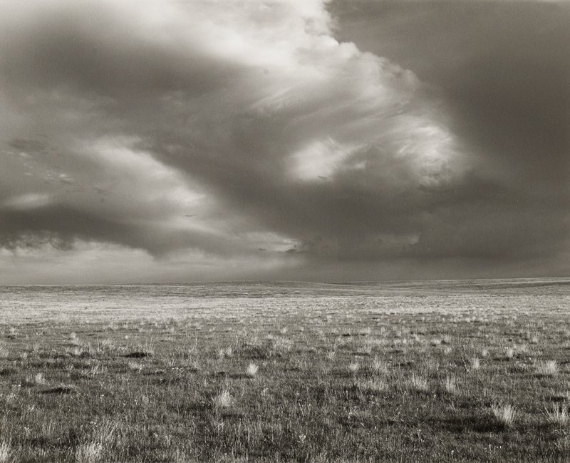 clouds over flat grassland