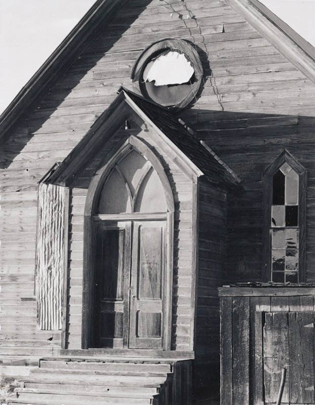 front of old, weathered church