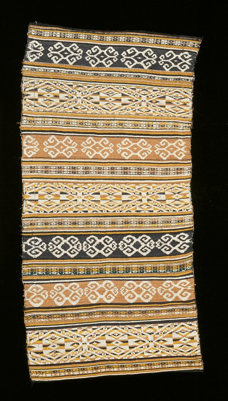 light brown, black, yellow, white; plain and patterned weave over green stripe