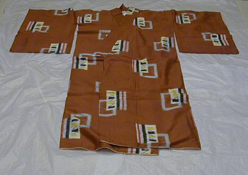 rust colored background with overlapping rectangular motifs: each rectangle is either a light blue frame, or has a white background with yellow and black decoration