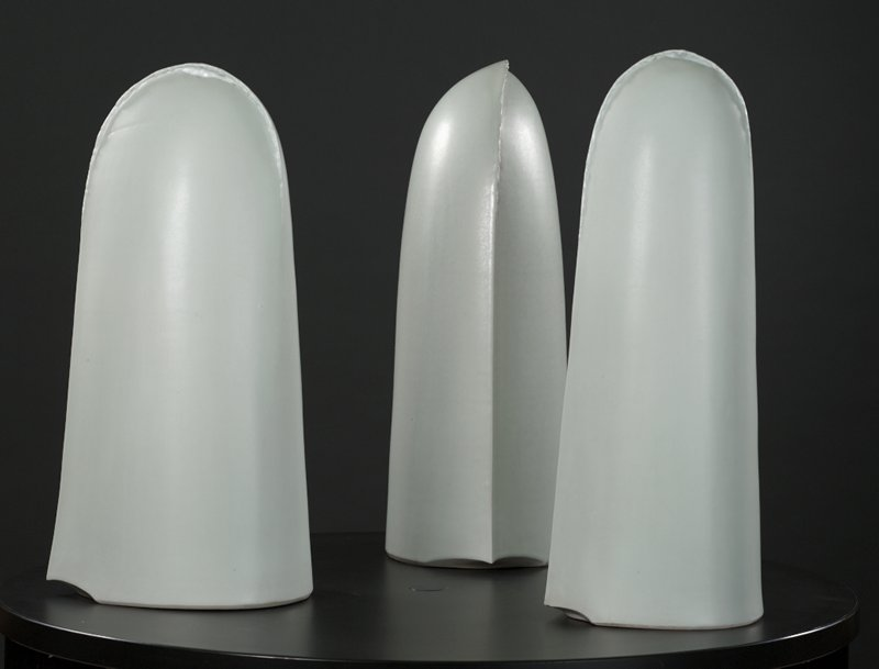 three tall domed forms with overlapping top seam and small opening at top