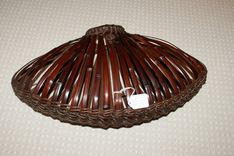 fan-shaped hanging basket made from thinly cut strips of bent bamboo; narrow mouth at top; oblong bamboo insert