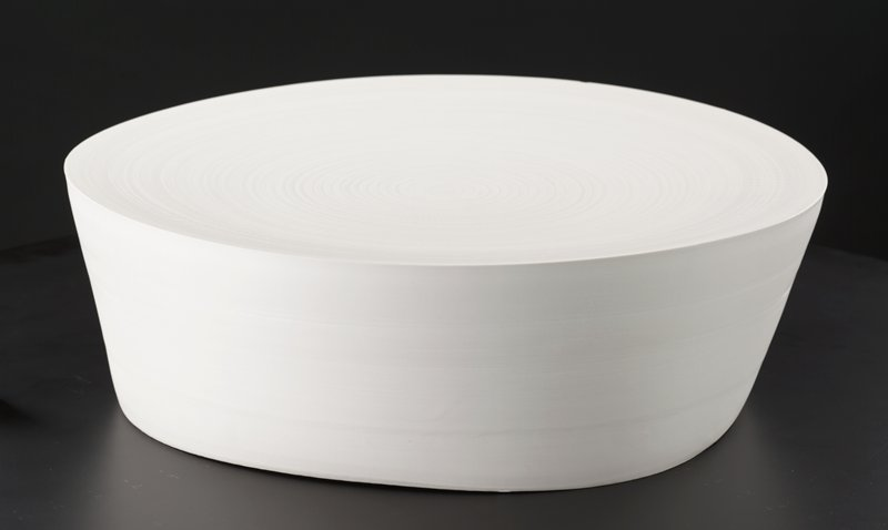 round, white form with flat top; very subtle concentric rings around top resembling cutting from a tree